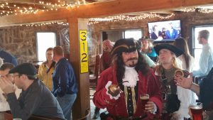 Renfest Pirates dance a jig during Pub Crawl